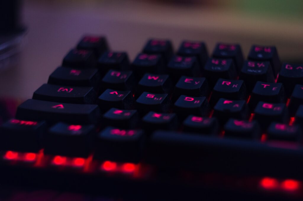 A black gaming keyboard that has glowing red characters
