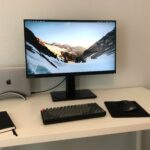 monitor, ipad, notebook, mouse, and keyboard sitting on white desk top