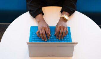 man typing on surface pro 3 laptop