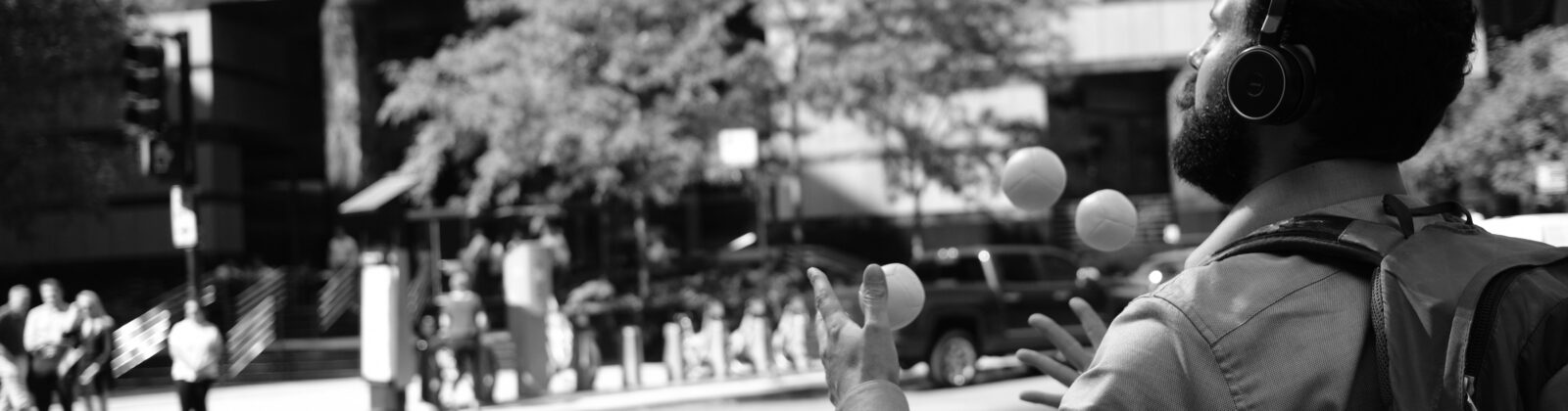 A person juggling tennis balls