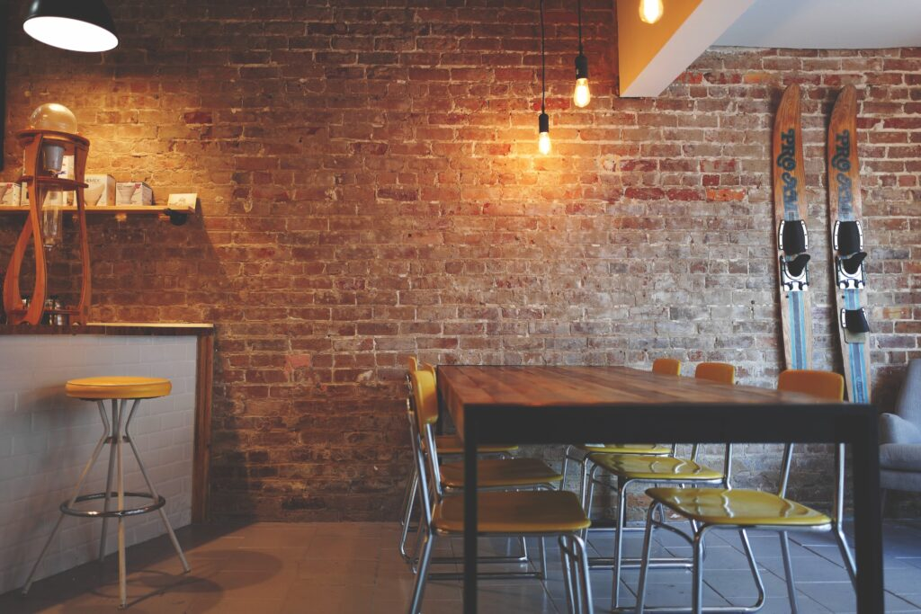 A coffee shop with a brick wall and warm lighting.