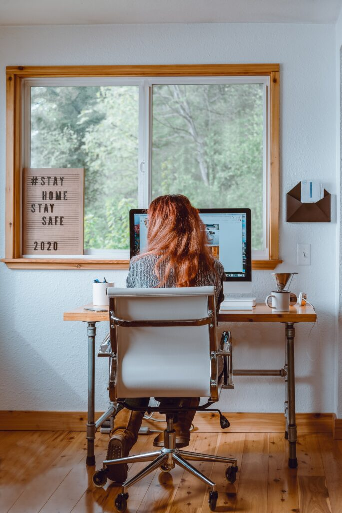a person with long hair working from home