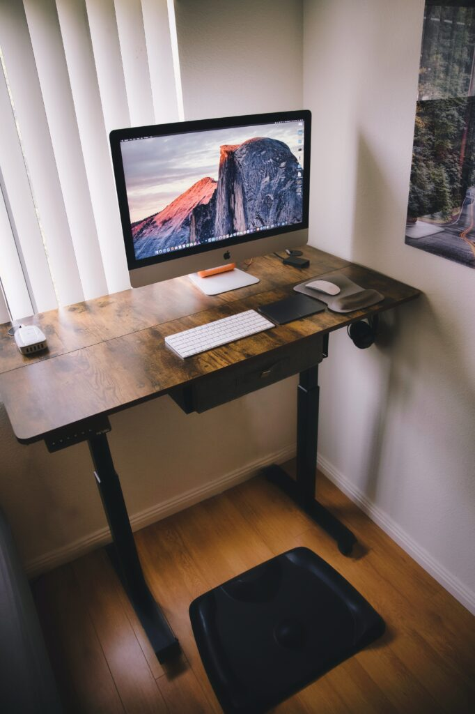 natural wood standing desk in a home office
