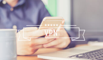 """person holding phone with banner that reads """"VPN"""" over the photo"""
