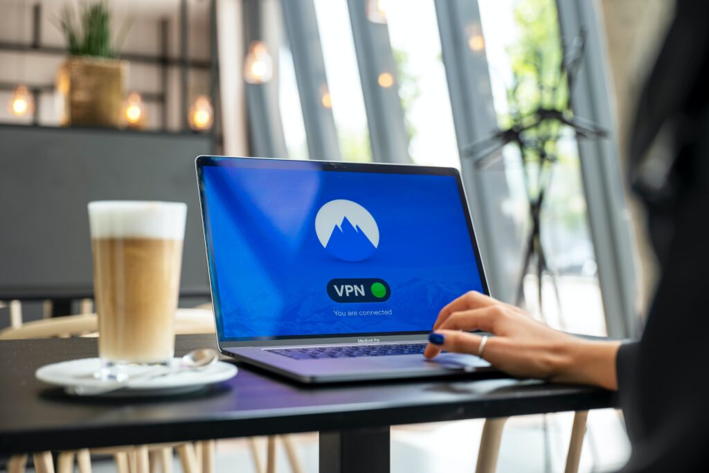 person typing on laptop using VPN services