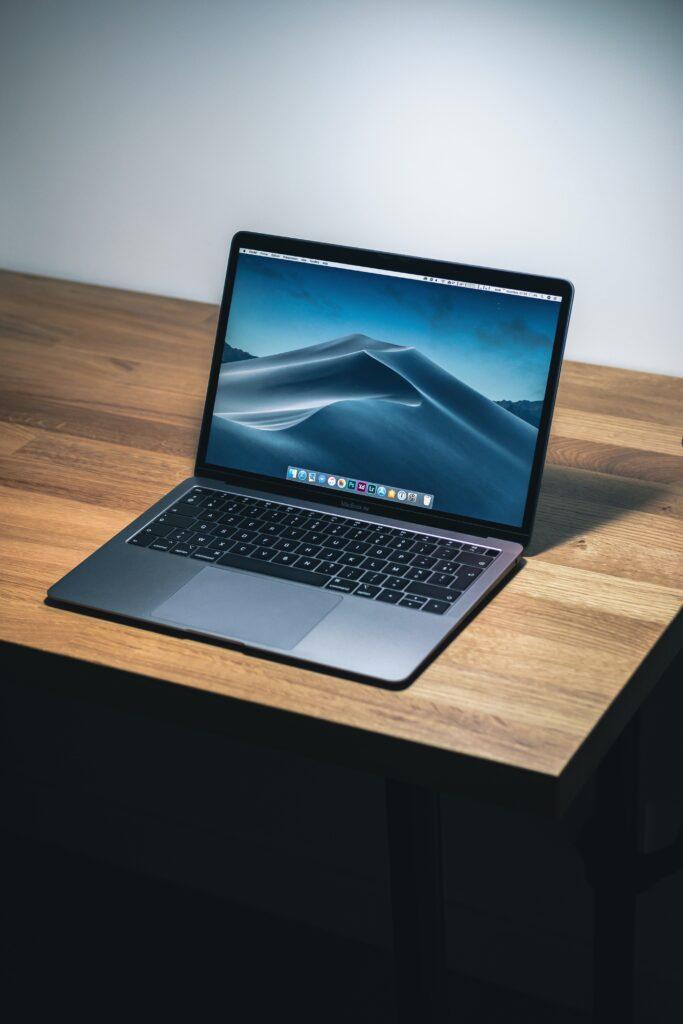 Macbook laptop sitting on a desk