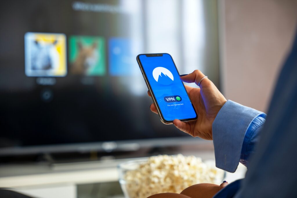 person holding phone with vpn protection showing on screen