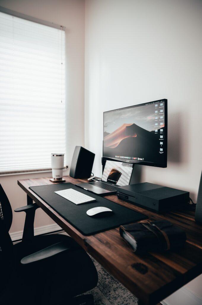 Acer monitor sitting on standing desk