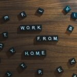 """Scrabble letter pieces that read """"Work From Home"""""""