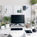 Computer monitor sitting at desk