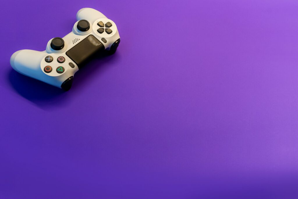 Playstation controller sitting against purple background