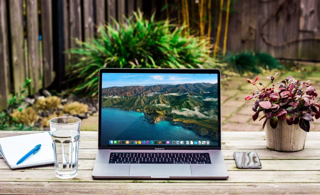 Laptop sitting on park bench