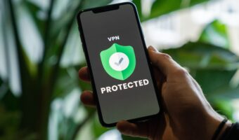 """Person holding phone that show """"VPN protected"""" on the screen"""