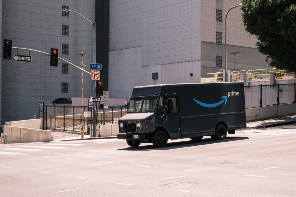 Amazon delivery truck driving through an intersection