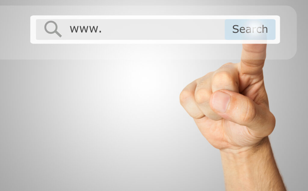 Finger hover over search bar, getting ready to search for a website