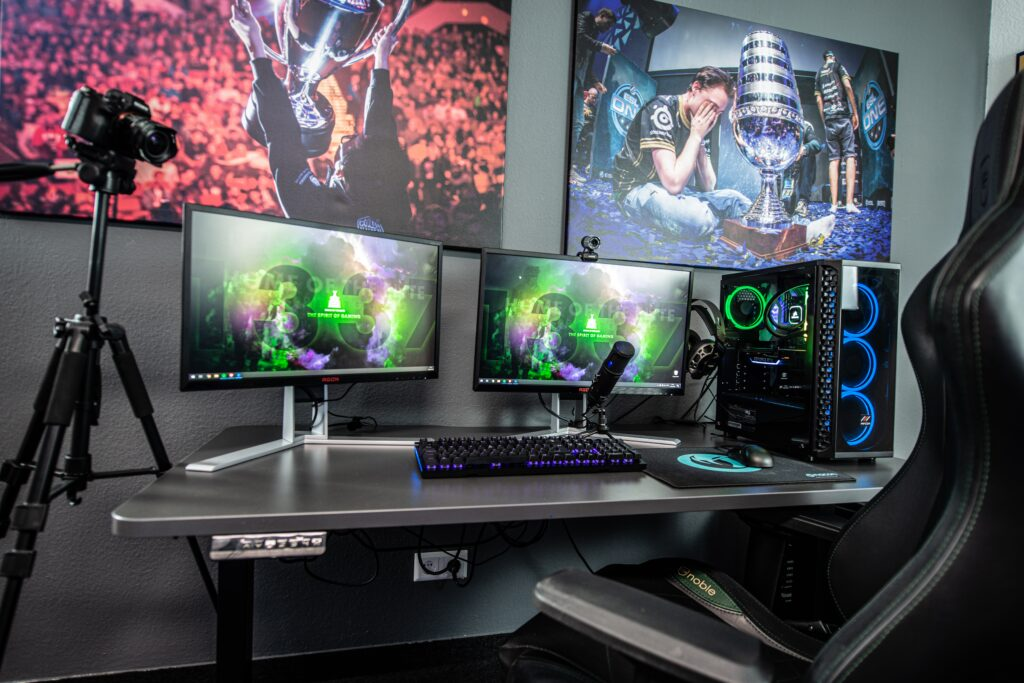 Gaming set up with two monitors and PC build next to them