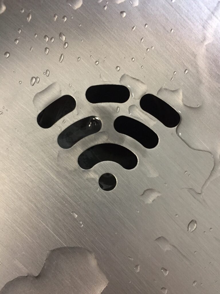 Metal with the wifi symbol carved out