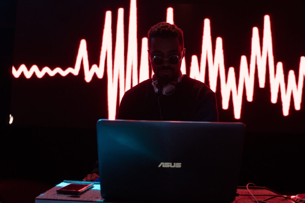 Person on ASUS computer with lights behind them.