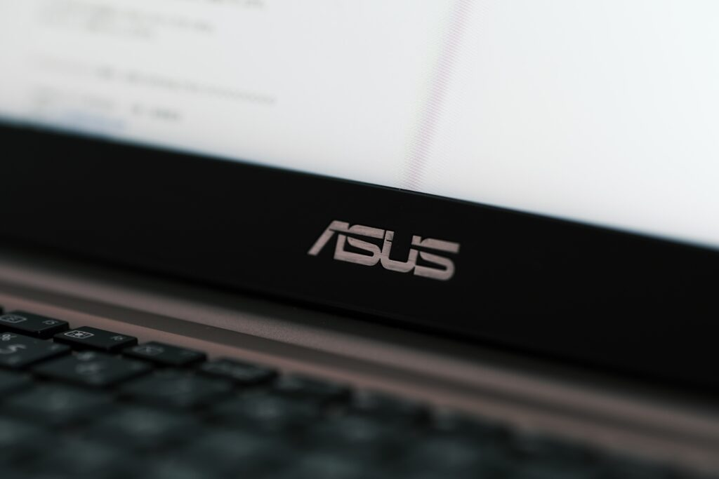 Close up view of ASUS logo on laptop computer