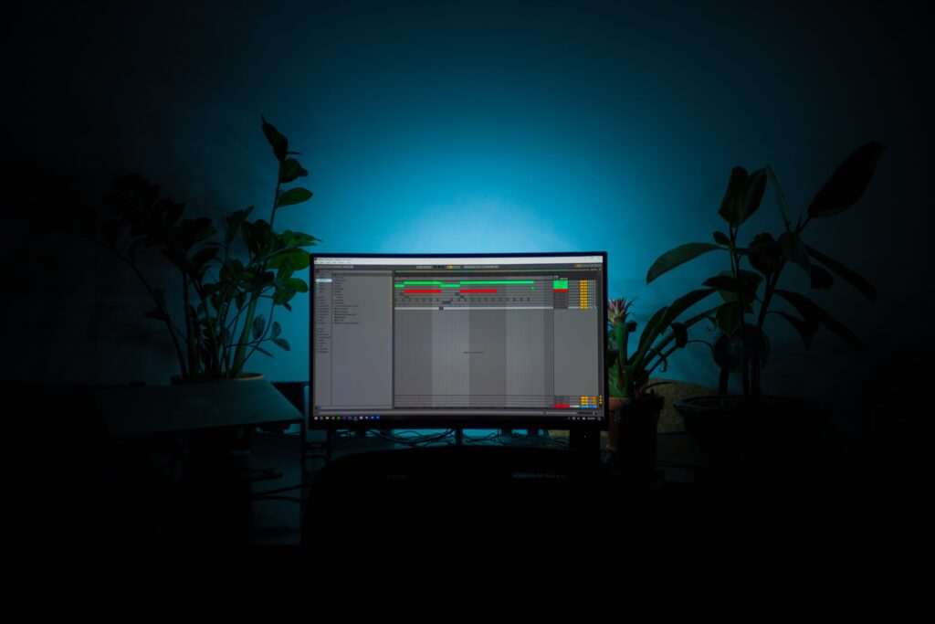 Computer monitor lit in dark room