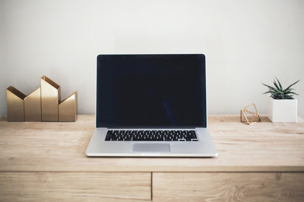 laptop sitting on a desk with blank screen
