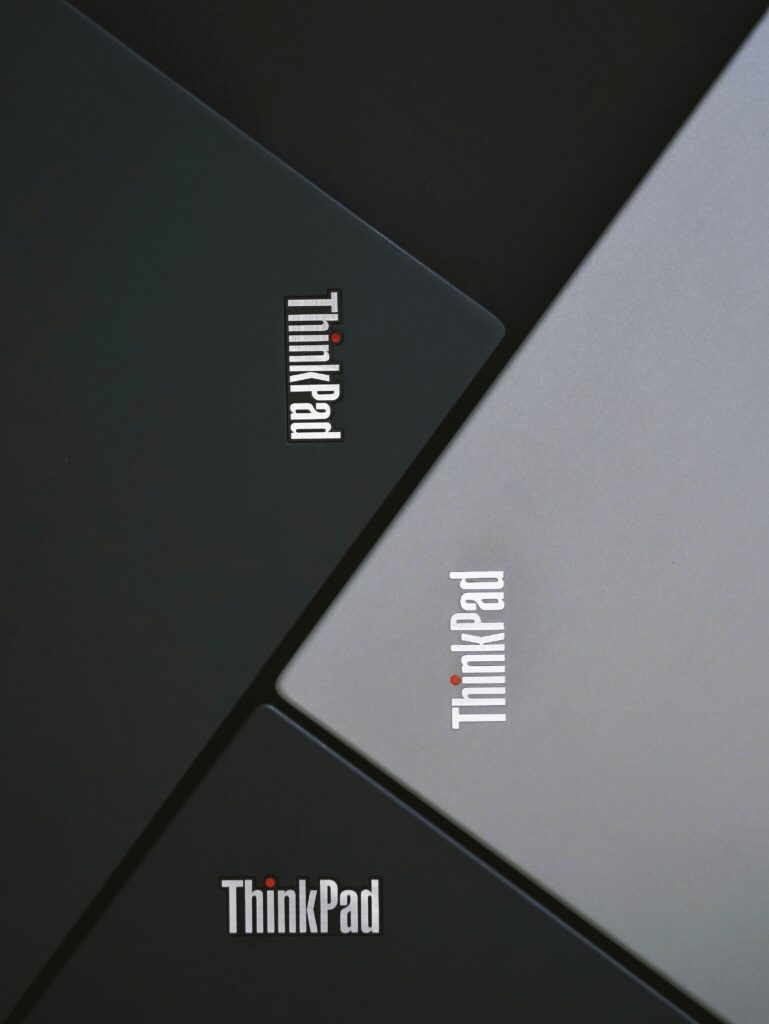 four lenovo thinkpad laptops lined up together